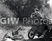Welcome to Danger -  Harold Lloyd in car, throw's 'bum' a bag