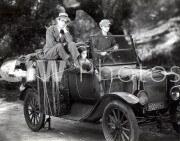 Welcome to Danger -  Harold Lloyd in car with 'bum'