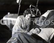 Welcome to Danger -  Harold Lloyd at camp, sweethear tucks him in