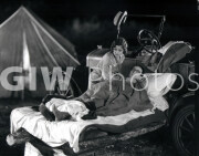 Welcome to Danger -  Harold Lloyd at camp, tucked in, tent in background