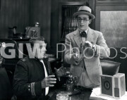 Welcome to Danger -  Harold Lloyd with cop, demonstration with cigar