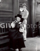 Welcome to Danger -  Harold Lloyd watched old lady with flower from behind