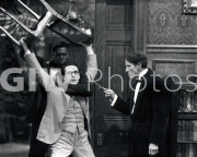 Welcome to Danger -  Harold Lloyd in headlock with chair overhead