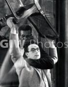 Welcome to Danger -  Harold Lloyd in headlock with chair overhead, CU