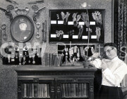 Welcome to Danger -  from photo cut from sequence - Harold Lloyd admires collectables
