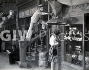Welcome to Danger -  from photo cut from sequence - Harold Lloyd reaches for umbrella