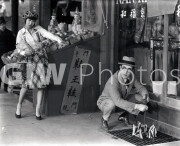 Welcome to Danger -  from photo cut from sequence - Harold Lloyd accused at sidewalk grate