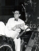 The Milky Way -  Behind the scenes- Harold Lloyd sitting on bicycle next to camera