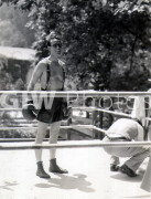The Milky Way -  Behind the scenes- Harold Lloyd in ring with crouching crew member