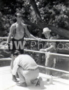 The Milky Way -  Behind the scenes- Harold Lloyd in ring with crouching crew member and man in hat