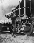 Lou Ambers boarding a train