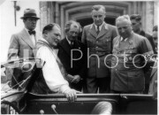 Hermann Goering with new Volkswagen convertible discuss the car