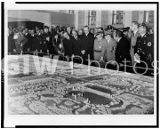 Adolf Hitler, Hermann G?ring, Ferdinand Porsche (on Hitler's left), and group of others looking at possible model of factory, at opening of automobile exhibition.