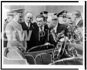 Hitler,  Goering and others looking at automobile