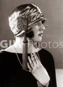 Hat fashion - April 1924Woman wearing elaborate hat with tassles??mirrorpix