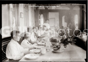 Probably New York City. July 17, 1909. Patients dining on ferryboat, which is used as a tuberculosis camp.