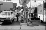June 15, 1979. cars lined up at a gas station waiting for fuel.