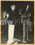 Washington, DC. August 11, 1932. President Herbert Hoover standing at a podium with NBC-Columbia microphones at