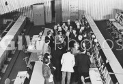 1975. The American ASTP crew are briefed on the operations of the consoles in the Soviet mission control center at the