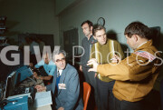 Four Soviet engineers participate in docking simulation exercises at the Johnson Space Center.