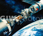 April 1975. An artist's concept illustrating a cutaway view of the docked Apollo and Soyuz spacecraft in Earth orbit.