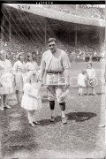 New York City. Babe Ruth with fans on field.
