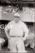 New York City. Babe Ruth in front of dugout.