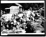 Philippines. 1942. Under Japanese guard the American POWs sort United States equipment. Following this, the Japanese