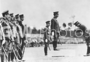 Emperor Hirohito delivering a message to Lt. General Hideki Tojo.