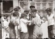 New York City. 1910s. Children getting drinks on hot day.