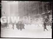 New York City. February 14, 1914. Pedestrians and a snowbound trolley in a blizzard.