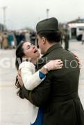 Andrews Air Force Base, Maryland. January 1981. A wife welcomes home her husband, a Marine who was held hostage in Iran.